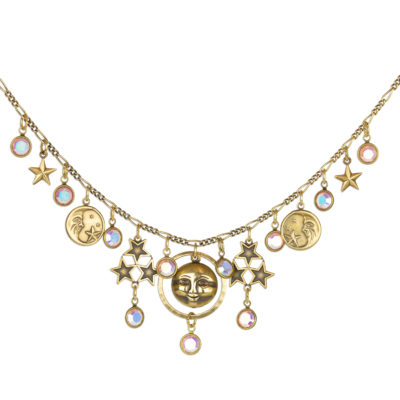 Whimsical celestial necklace adorned in sun and star charms. Handcrafted Jewelry by Anne Koplik Designs.
