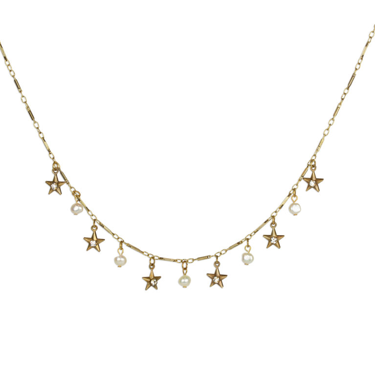 Whimsical celestial necklace adorned in star charms and pearls from Swarovski®. Handcrafted by Anne Koplik Designs.
